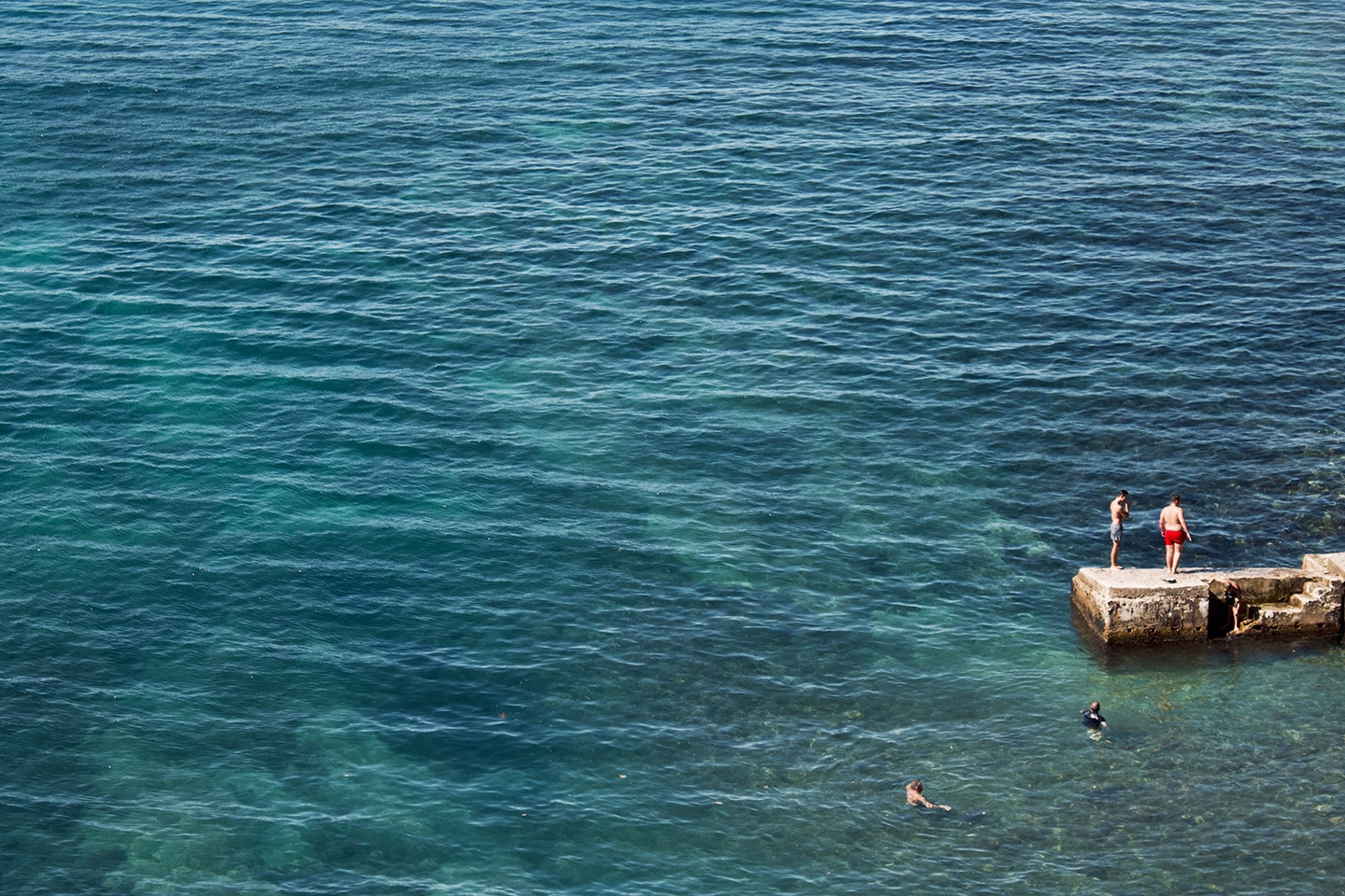 Group of boys enjoying the sea in Cassis - France
