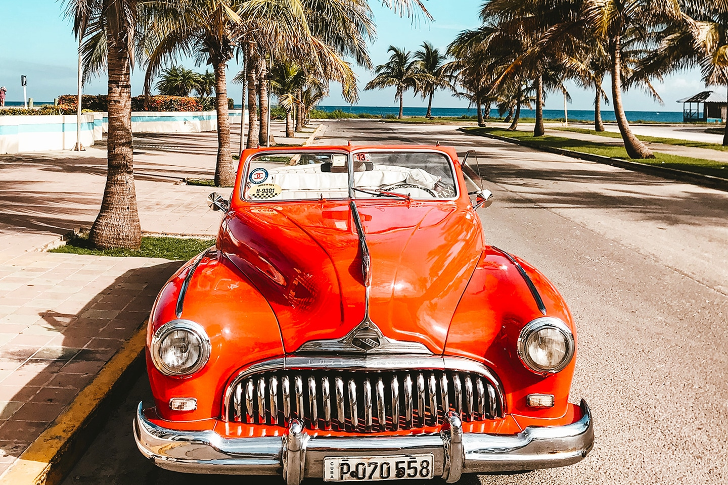 Old car at the beach in Cuba