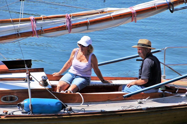 People on a boat wearing sun hats