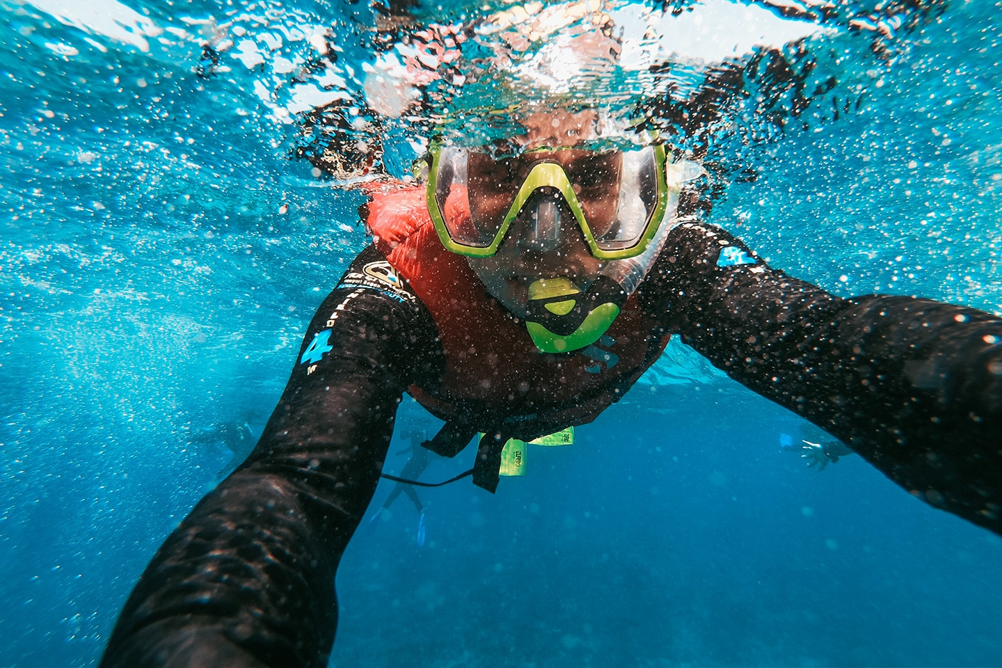 Snorkeler in rash guard