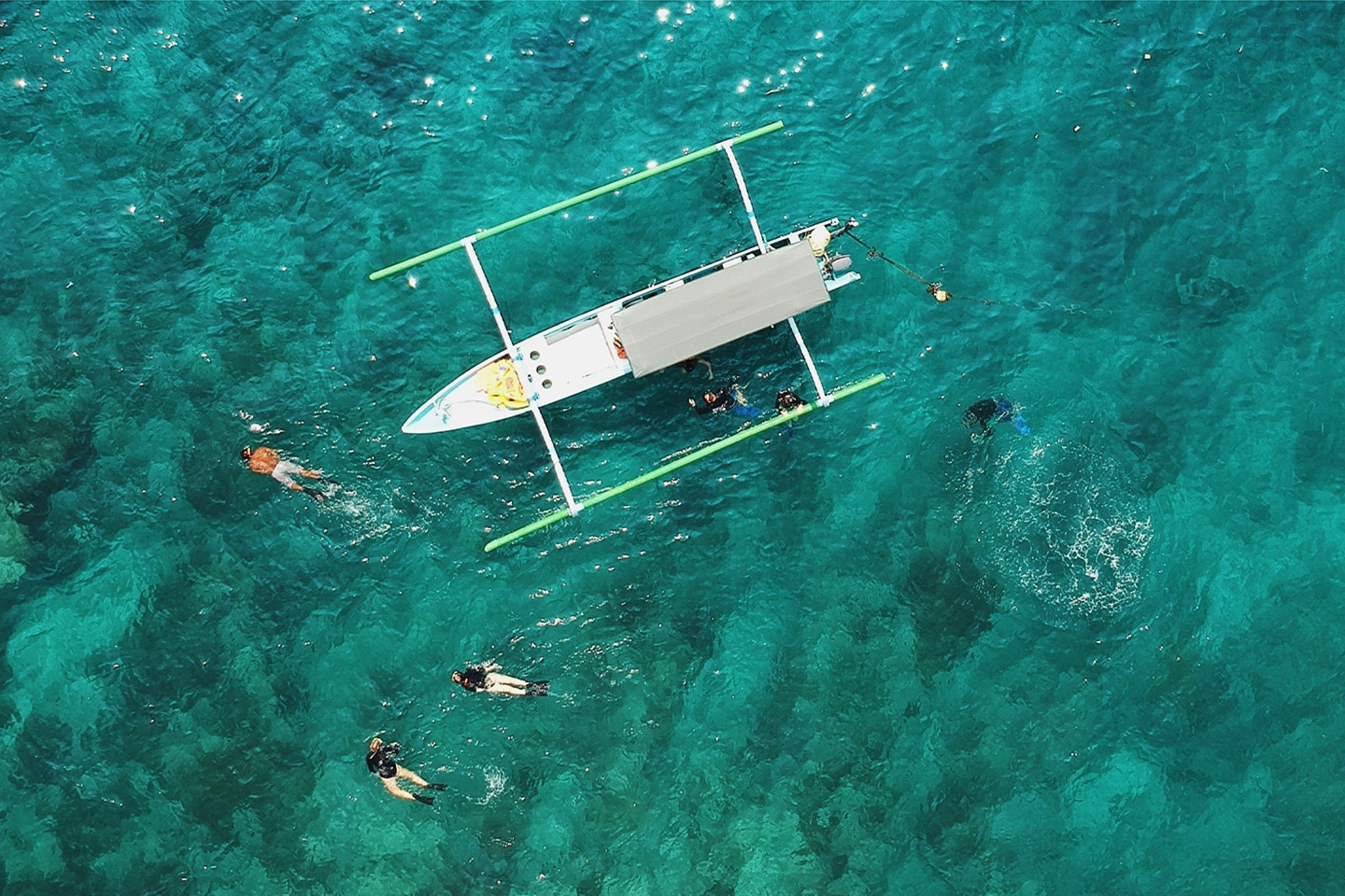 Snorkelers next to a boat