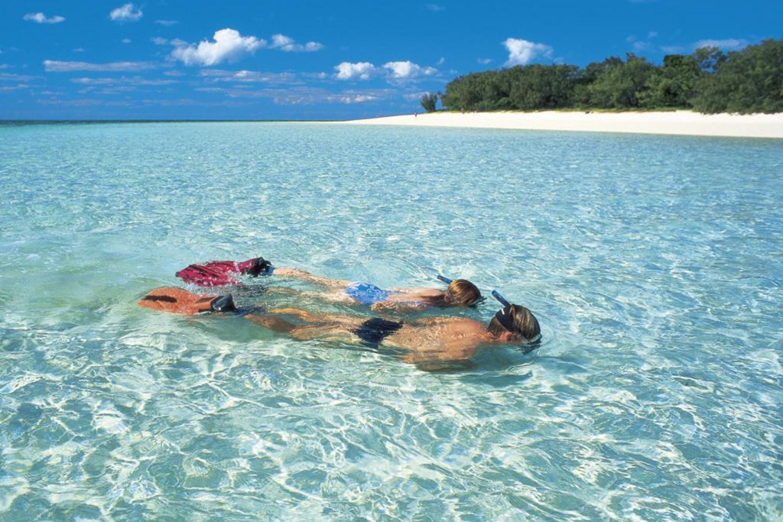Snorkeling couple near the shore