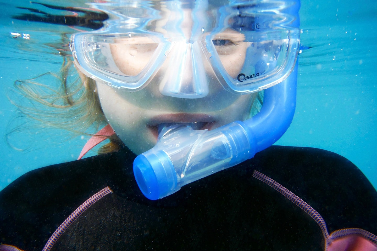 small girl with a snorkel