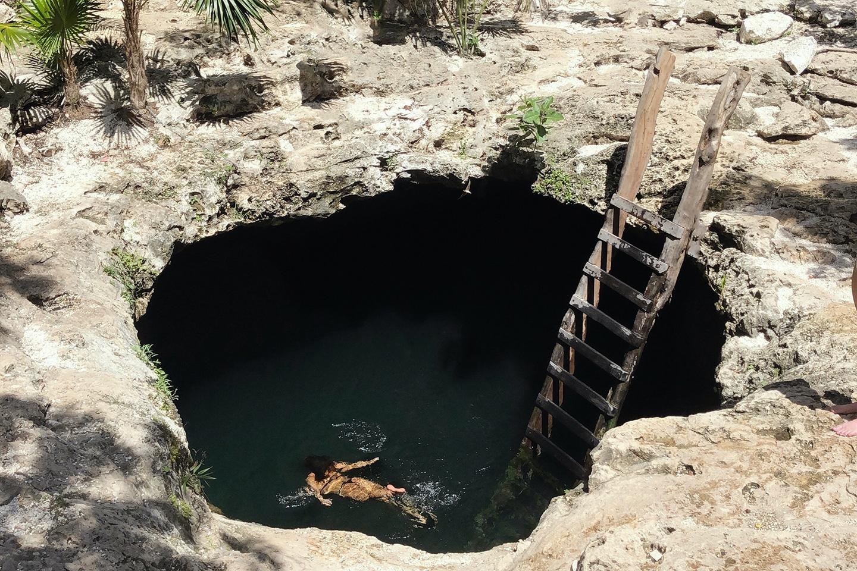swimming in cenote calavera