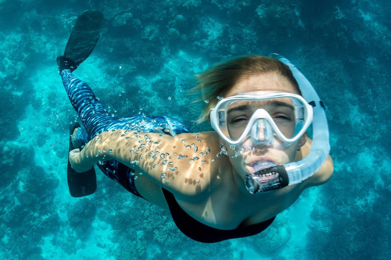 girl wearing one window snorkel mask