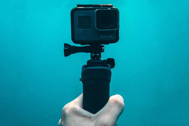 gopro camera on a handgrip underwater