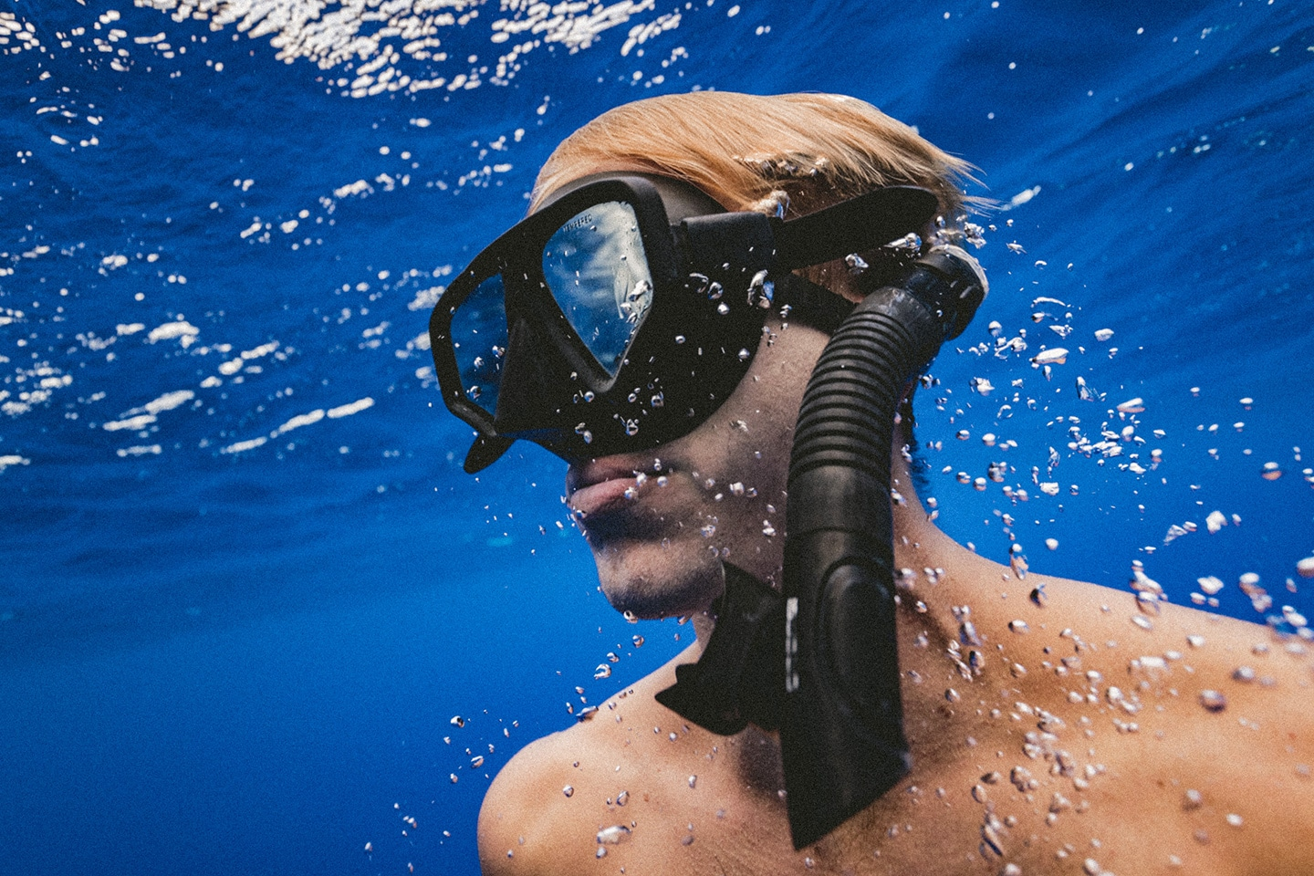 Man underwater with mask and snorkel