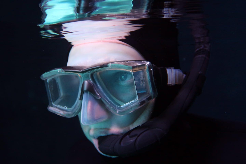 man wearing panoramic snorkel mask