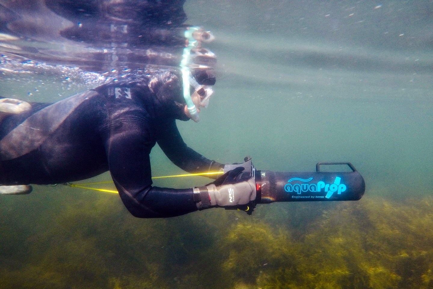 Man underwater with sea scooter