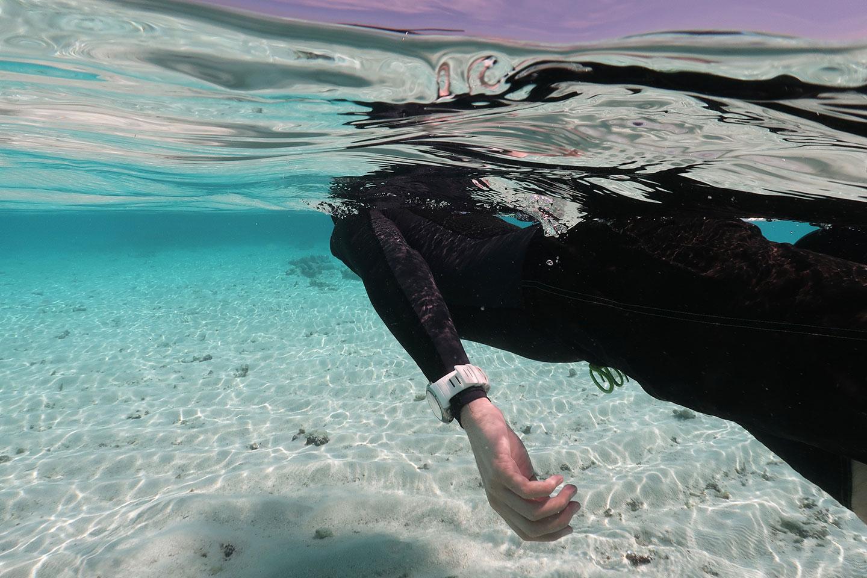 Snorkeler wearing a dive computer