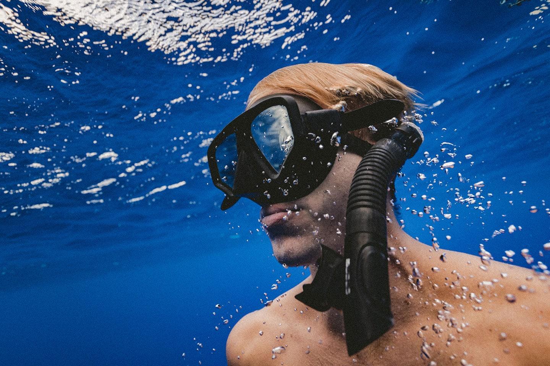 Clean shaven man snorkeling