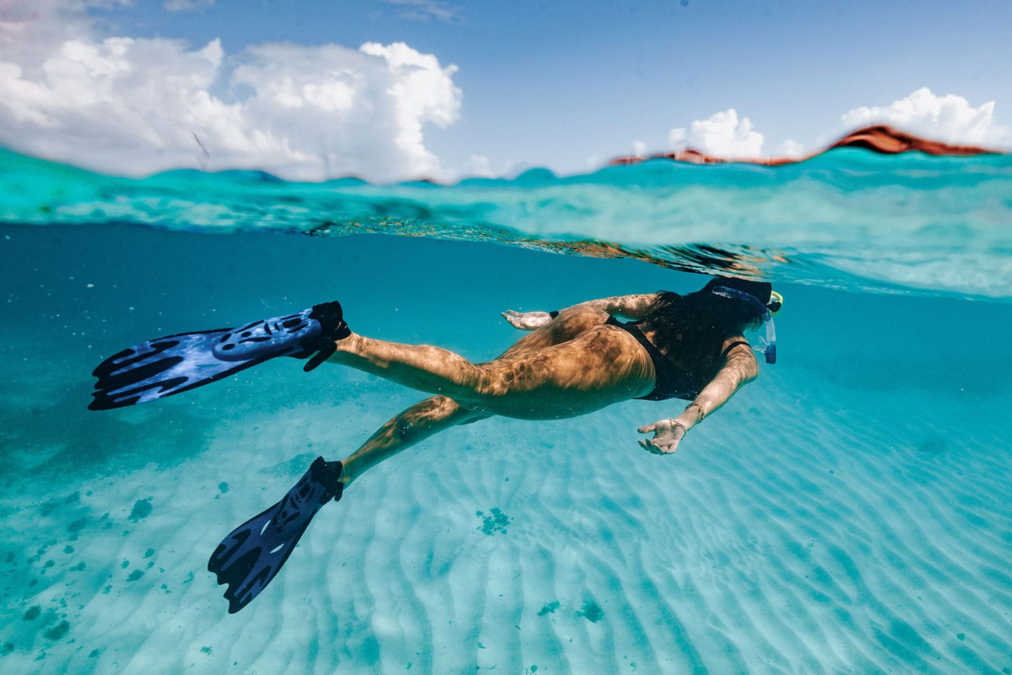 Girl snorkeling in shallow water