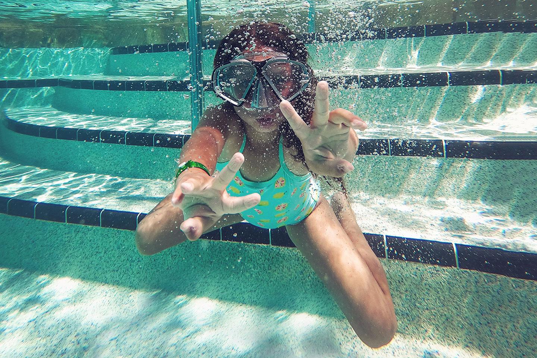 Girl snorkeling in the pool
