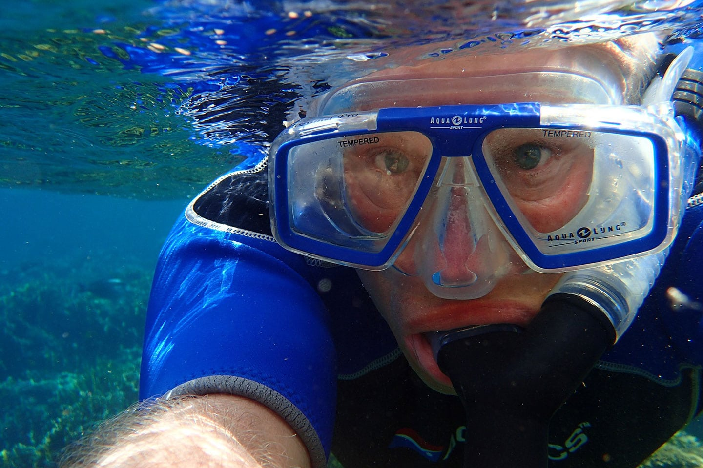 Man wearing tempered glass snorkeling goggles