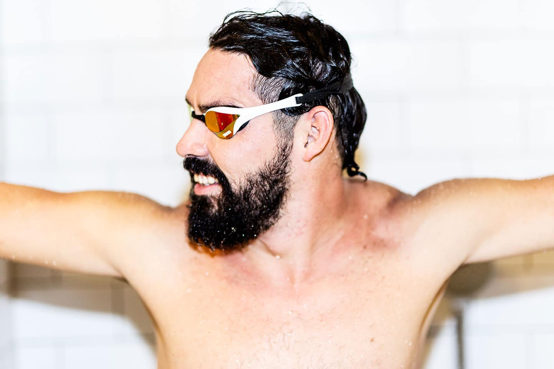 Man with beard wearing swim goggles